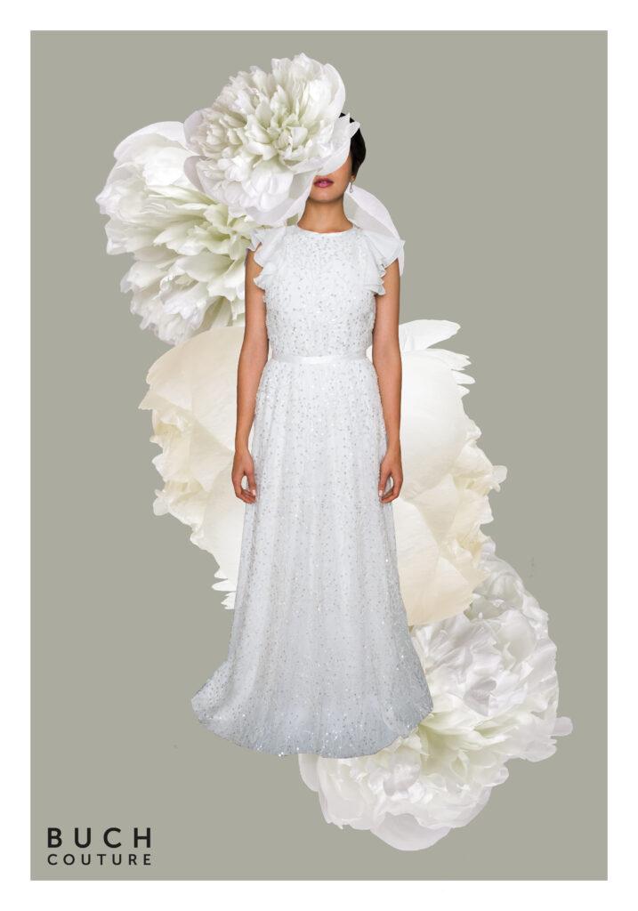 brudekjole inspireret af 1920'erne med pailletter, broderier og delikate mønstre og lette korte flæseærmer i chiffon